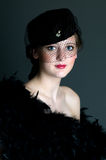 Vintage Model. Young model wearing vintage hat and feather boa Stock Photography