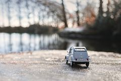 Vintage model car at the water side with bokeh background Royalty Free Stock Photography