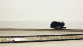 Vintage Model Steam Locomotive Running on the Rails stock video