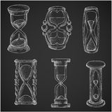 Vintage and modern hourglasses chalk sketches Royalty Free Stock Photography