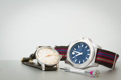 A vintage and modern watch Royalty Free Stock Images