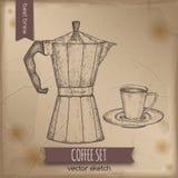 Vintage moka espresso maker and coffee cup. Stock Photos