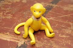 Vintage monkey. Old plastic monkey toy sitting Stock Photography