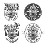 Vintage monochrome firefighting emblems set. With ferocious bear heads in fireman helmet and axes isolated vector illustration vector illustration
