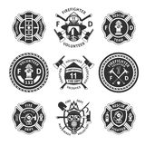 Vintage Monochrome Firefighting Labels Set. With inscriptions crossed axes mask extinguisher hydrant ladder shovel isolated vector illustration Stock Photos