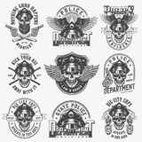 Vintage monochrome police labels set. With skulls in policeman hat eagle wings pistols crossed batons isolated vector illustration vector illustration