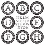 Vintage monogram kit. Black patterned letters and floral round frames Royalty Free Stock Photo