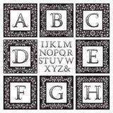 Vintage monogram kit. Black patterned letters and floral square frames Royalty Free Stock Photo