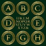 Vintage monogram kit. Golden letters and floral round frames Stock Photography