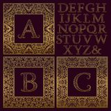 Vintage monogram kit. Golden patterned letters and ornate square frames for creating initial logo in antique style.  Royalty Free Stock Photography