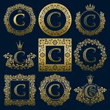 Vintage monograms set of C letter. Golden heraldic logos in wreaths, round and square frames.  Stock Photography