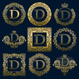 Vintage monograms set of D letter. Golden heraldic logos in wreaths, round and square frames.  Stock Image