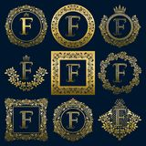 Vintage monograms set of F letter. Golden heraldic logos in wreaths, round and square frames.  Stock Photo