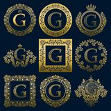 Vintage monograms set of G letter. Golden heraldic logos in wreaths, round and square frames.  Royalty Free Stock Photography