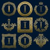 Vintage monograms set of I letter. Golden heraldic logos in wreaths, round and square frames.  Royalty Free Stock Images