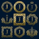 Vintage monograms set of J letter. Golden heraldic logos in wreaths, round and square frames.  Royalty Free Stock Images