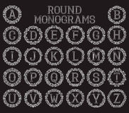 Vintage monograms set in round floral frames. Royalty Free Stock Images