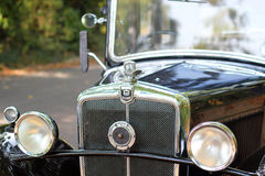 Vintage morris ten badge and radiator grill or grille. Royalty Free Stock Photography