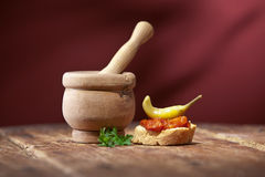 Vintage mortar and  bread whith hot pepper saus Stock Photos