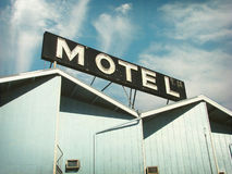 Vintage motel and sign. Aged and worn vintage photo of motel sign Stock Image