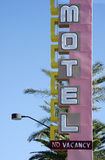 Vintage motel sign. An old motel sign with palm trees in the background stock photography
