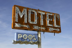 Vintage motel sign on route 66. Old, worn out vintage motel sign on route 66 in Arizona Royalty Free Stock Photo
