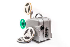 Vintage motion picture film projector and reel of motion picture. Retro old reel movie projector for cinema. A reels of motion picture film on a white background Royalty Free Stock Photo