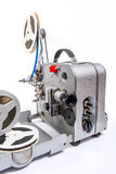 Vintage motion picture film projector and reel of motion picture. Retro old reel movie projector for cinema. A reels of motion picture film on a white background Royalty Free Stock Photos