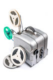Vintage motion picture film projector and reel of motion picture. Retro old reel movie projector for cinema. A reels of motion picture film on a white background Royalty Free Stock Images