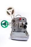 Vintage motion picture film projector and reel of motion picture. Retro old reel movie projector for cinema. A reels of motion picture film on a white background Stock Images