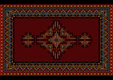 Vintage motley luxury carpet with ethnic ornament on a maroon field Stock Photo
