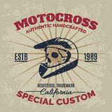 Vintage motocross helmet with skull for printing with grunge texture. Royalty Free Stock Image
