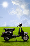 Vintage motorbike on the field Royalty Free Stock Photos