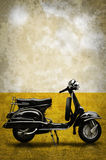 Vintage motorbike on field in retro style. Vintage motorbike on field with sky background in retro style Royalty Free Stock Photo