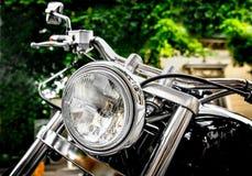 Vintage Motorbike Headlight. Vintage black motorbike with round headlight Stock Photography
