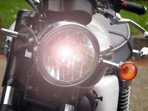 Vintage motorbike motorcycle triumph bonneville headlamp light. Photo of vintage classic triumph bonneville motorcycle with details showing headlamp illuminated royalty free stock photo