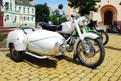 Vintage motorcycle. Old white vintage motorcycle with trailer Stock Image