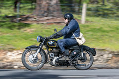 Vintage Motorcycle on country road. Adelaide, Australia - September 25, 2016: Vintage Motorcycle on country roads near the town of Birdwood, South Australia Stock Photography