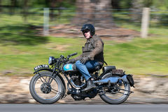 Vintage Motorcycle on country road. Adelaide, Australia - September 25, 2016: Vintage Motorcycle on country roads near the town of Birdwood, South Australia Royalty Free Stock Images