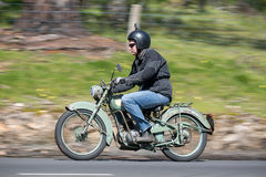 Vintage Motorcycle on country road. Adelaide, Australia - September 25, 2016: Vintage Motorcycle on country roads near the town of Birdwood, South Australia Stock Image