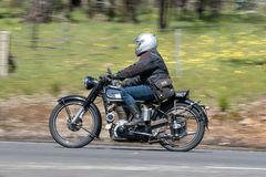 Vintage Motorcycle on country road. Adelaide, Australia - September 25, 2016: Vintage Motorcycle on country roads near the town of Birdwood, South Australia Royalty Free Stock Photography
