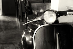 Vintage motorcycle -Decorations in the cafe. Coffee shop. black and white color effect styles royalty free stock photos