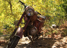 Vintage motorcycle. Vintage or retro brown motorcycle parked royalty free stock photography