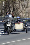 Vintage Motorcycle with sidecar on country road Stock Images