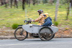 Vintage Motorcycle with sidecar on country road. Adelaide, Australia - September 25, 2016: Vintage Motorcycle with sidecar on country roads near the town of Stock Photos