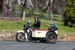 Vintage Motorcycle with sidecar on country road Royalty Free Stock Photos