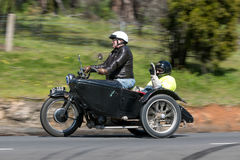 Vintage Motorcycle with sidecar on country road Royalty Free Stock Images