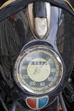 Vintage motorcycle speedo. Classic vintage motorcycle speedometer at top of headlight Stock Photo