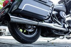 Close up of Vintage motorcycle parking on the road. Croped view royalty free stock photography