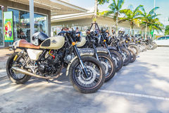 Vintage motorcycles parked in the parking lot Royalty Free Stock Images
